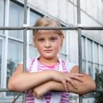 Girl riding rides on a child playground — Stock Photo #14036544