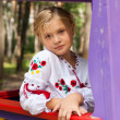 Girl on a child playground with various rides — Stock Photo #14038247