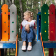 Child in Ukrainian style shirt on a swing — Stock Photo #14038413