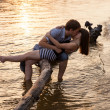 Couple hugging and kissing at riverside — Stock Photo