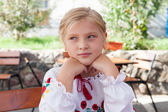 Young girl posing in an outdoor cafe — Stock Photo