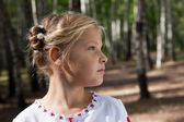 Child girl portrait in a birch forest — Stock Photo