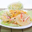 Mixed salad with white dressing served pretty on a large plate - Stock Photo