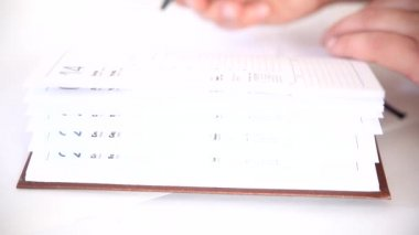 Man writing information in business agenda book — Vidéo