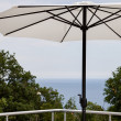 Beach umbrella with sea in background — Foto Stock