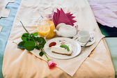 Romantic breakfast on bed — Stock Photo