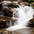 Cascade falls over mountain rocks — Stock Photo #49793929