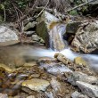 Cascade falls over mountain rocks — Stock Photo #49793949