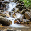 Cascade falls over mountain rocks — Stock Photo #49794245