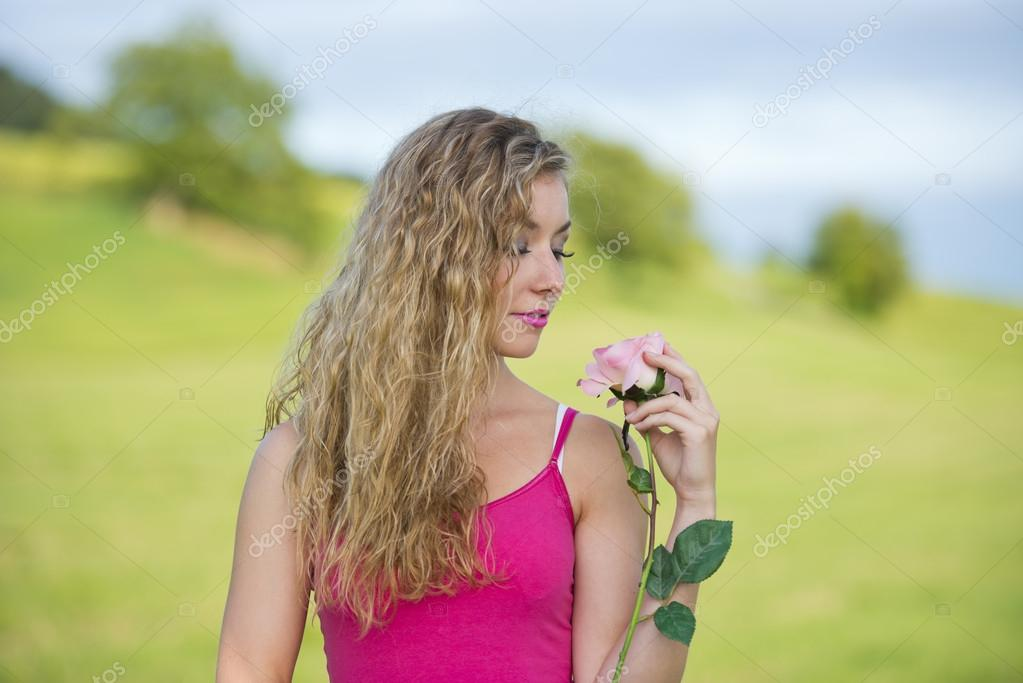Beautiful blonde teeny girl with a rose  Stock Photo #14092394