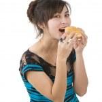 Young woman eating a hamburger — Stock Photo #8222865