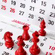 Chess Pieces on Calendar - Stock Photo