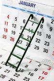Ladder on Calendar — Stock Photo
