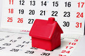 Miniature House on Calendar Pages — Stockfoto