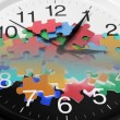Stock Photo: Clock and Puzzle Pieces