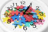 Clock and Puzzle Pieces — Stock Photo