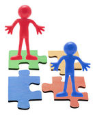 Miniature Figures Standing on Jigsaw Puzzle Pieces — Stock Photo