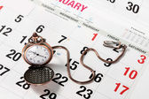 Pocket Watch on Calendar — Stock Photo