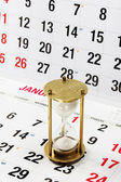 Hourglass on Calendar Page — Stock Photo