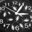 Foto de Stock  : Toy Cockroaches on Clock