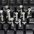 Royalty-Free Stock Photo: Computer Keyboard and Screws