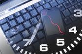 Laptop and Clock — Stock Photo