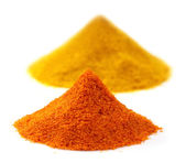 Pile of ground peppers and ground turmeric — Stock Photo