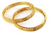 Wedding gold bracelets for Indian bride — Stock Photo