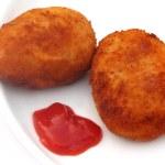Potato chops with tomato ketchup — Stock Photo #25760781