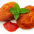 Potato chops with tomato ketchup and fresh mint leaves — Stock Photo