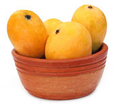Fresh Mangoes on a clay bowl — Stock Photo