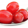 Processed cherry with a silver spoon — Stock Photo