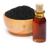 Nigella sativa or Black cumin with essential oil — Stock Photo