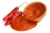 Red hot chilies with paste — Stock Photo