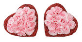 Two paper hearts in decorative roses. — Stock Photo