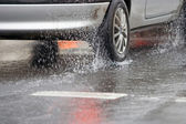 Car riding on wet roads — Stock Photo