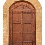 Wooden closed brown door. — Stock Photo #13796567