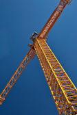 Yellow construction crane. — Photo