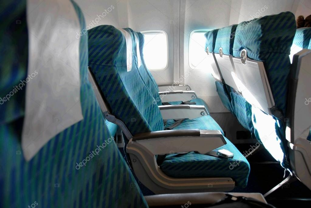 Row of blue seats indoors in passenger airplane — Stock Photo #13172237