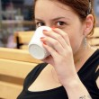 Young woman portrait drinking coffee — Stock Photo