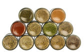 Colorful powder spices in glass bottle — Stock Photo