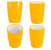 Yellow plastic glass for juice — Stock Photo