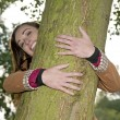 Woman hugging a tree — Stock Photo #15893311