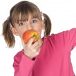 Child biting into an apple — Stock Photo