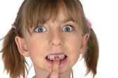 Little girl pointing at her first fallen out milk teeth — Stock Photo