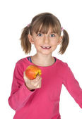 Young girl with missing teeth eating an apple — Stock Photo