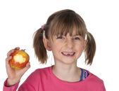 Liitle girl baring missing milk teeth — Stock Photo
