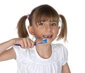 Young girl brushing teeth — Stock Photo