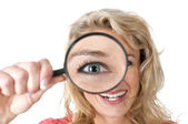 Woman with loupe and huge eye — Stock Photo