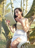 Shocked woman with tablet pc — Stok fotoğraf